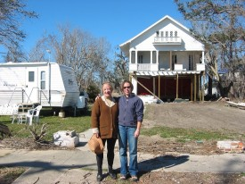 Owner Mary Helen Schaeffer and volunteer engineer Beth Nathan stand in front of Schaeffer's damaged house on Scenic Drive.