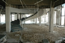Excerpt from conservation report for Gulfport Public Library: The first floor was gutted and scrubbed clean by the storm surge. Some windows were blown out on the second floor. No one was there.