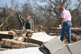Grady Howell (MDAH) walks among debris at Beauvoir. This property had severe damage from flood waters estimated at 30 feet. The first floors of both the historic house and library were gutted by the storm surge. (Christine Wiseman)