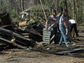 SCAD students salvage pieces of the Charnley and Sullivan houses from the debris pile behind the property, March 2006