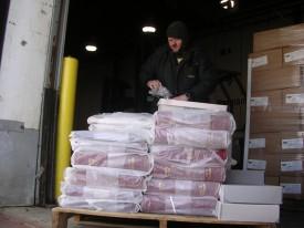 Jackson storage freezer employee wraps books before placing them in the freezer.